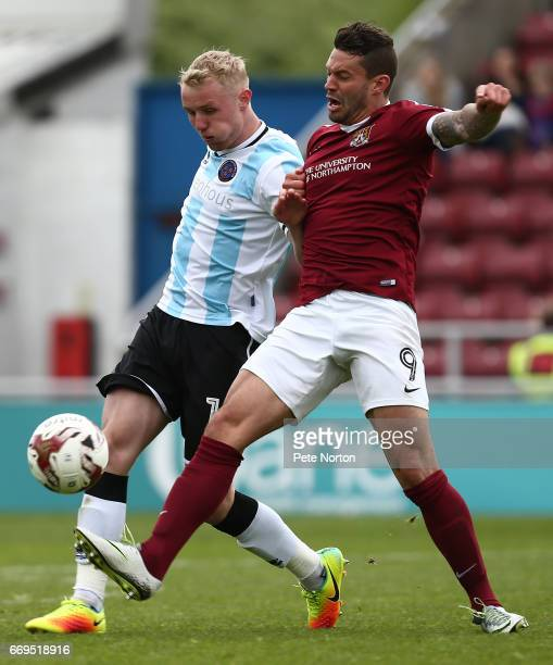 Jack Grimmer of Shrewsbury Town contests the ball with Marc Richards of Northampton Town during the Sky Bet League One match between Northampton Town...