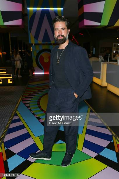 Jack Guiness attends Adam Nathaniel Furman's 'Chromacolour Catwalk' for Artist Playground by Pullman on June 28 2018 in London England