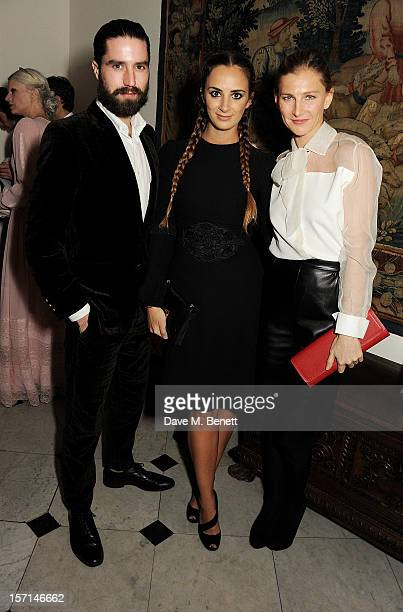 Jack Guinness Alexia Niedzielski and Elizabeth Von Guttman attend a dinner celebrating the launch of 'Valentino Master Of Couture' the new exhibition...