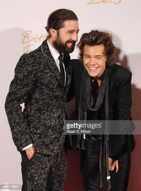 Jack Guinness and Harry Styles with the British Style bought to you by Vodaphone Award and Alexa Chung poses in the winners room at the British...