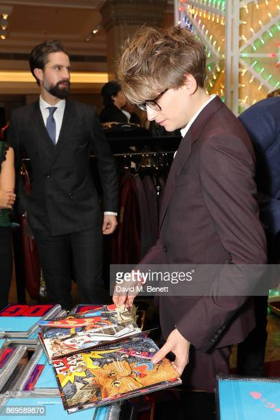 Jack Guinness and Luke Hall attend the Dolce Gabbana Italian Christmas Millennial Book Signing at Harrods on November 2 2017 in London England