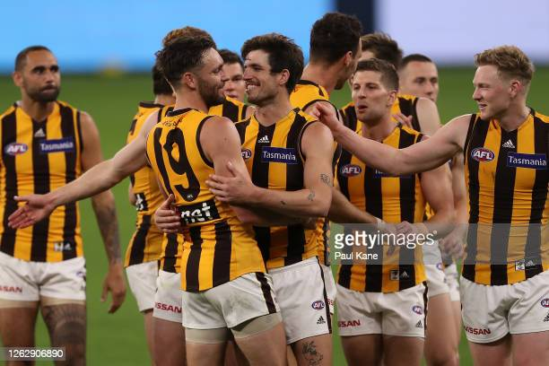 Jack Gunston and Ben Stratton of the Hawks celebrate after winning the round nine AFL match between the Carlton Blues and the Hawthorn Hawks at Optus...