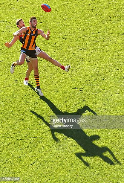 Jack Gunston of the Hawks and Jeremy Howe of the Demons compete for a mark during the round seven AFL match between the Hawthorn Hawks and the...
