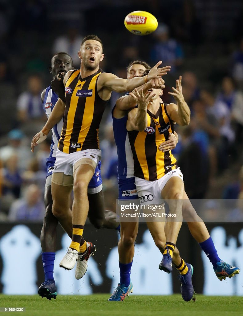 Jack Gunston of the Hawks and Majak Daw of the Kangaroos compete for the ball during the 2018 AFL round five match between the North Melbourne Kangaroos and the Hawthorn Hawks at Etihad Stadium on April 22, 2018 in Melbourne, Australia.
