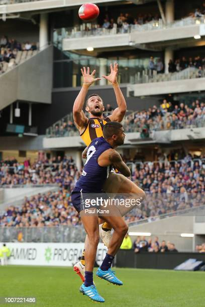 Jack Gunston of the Hawks marks the ball against Bradley Hill of the Dockers during the round 19 AFL match between the Fremantle Dockers and the...