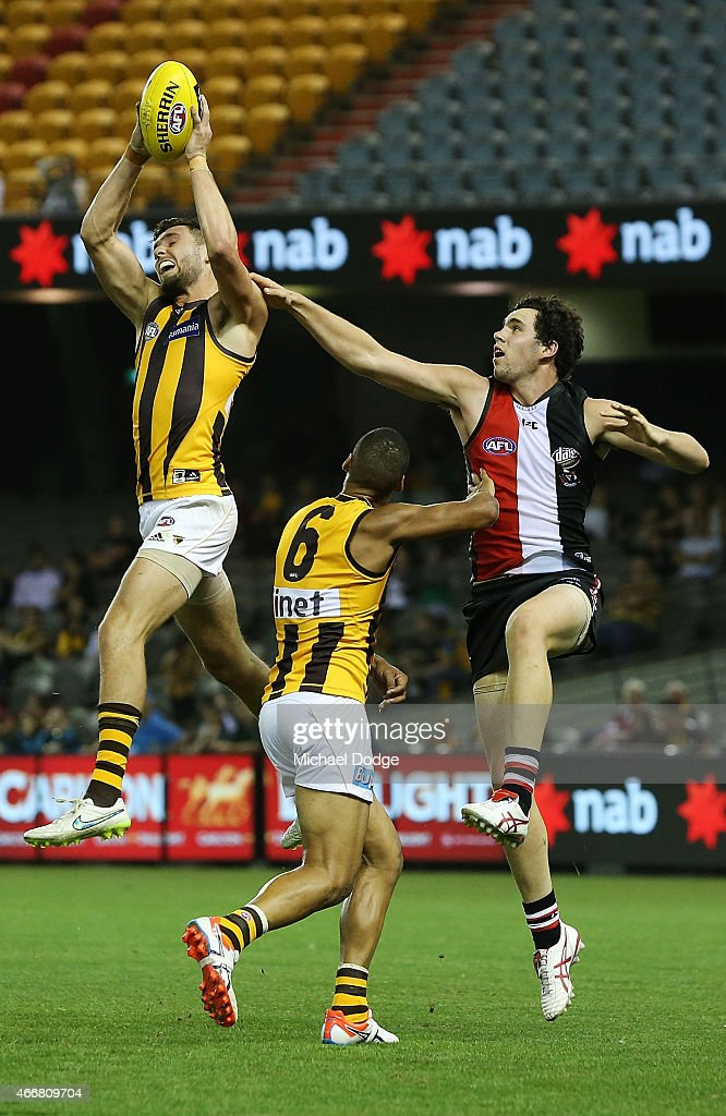Jack Gunston of the Hawks marks the ball against Paddy McCartin of the Saints of the Saints during the NAB Challenge AFL match between St Kilda Saints and Hawthorn Hawks at Etihad Stadium on March 19, 2015 in Melbourne, Australia.