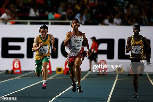 Jack Hale of Australia Abdul Hakim Sani Brown of Japan and Andre Morrison of Jamaica in action during the Boys 100 Meters Simifinal on day one of the...