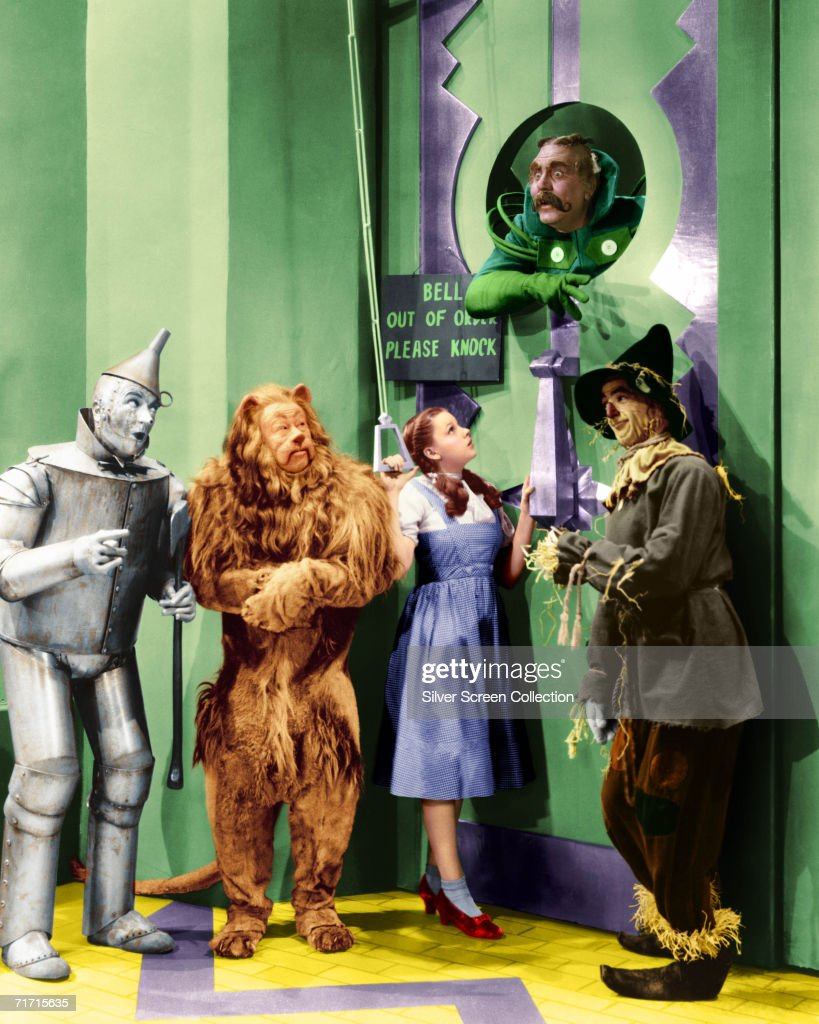 Jack Haley (1898 - 1979) as the Tin Man, Bert Lahr (1895 - 1967) as the Cowardly Lion, Judy Garland (1922 - 1969) as Dorothy, Ray Bolger (1904 - 1987) as the Scarecrow and Frank Morgan (1890 - 1949) as the Doorman to the Emerald City in 'The Wizard of Oz', 1939.