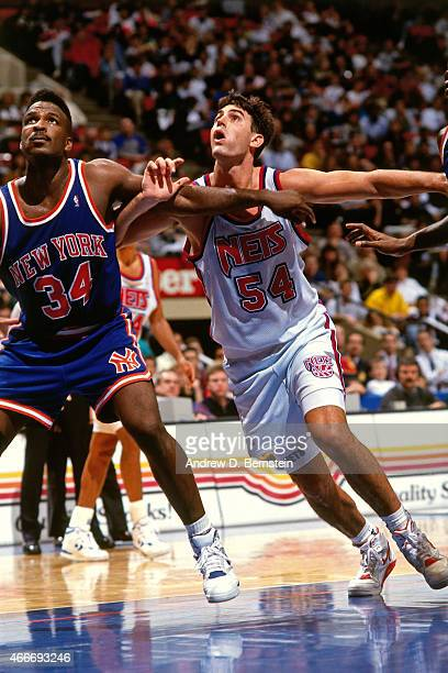 Jack Haley of the New Jersey Nets battles for position against Charles Oakley of the New York Knicks circa 1990 at Brendan Byrne Arena in East...