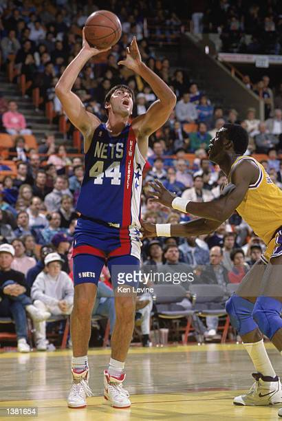 Jack Haley of the New Jersey Nets shoots the ball over Orlando Woolridge of the Los Angeles Lakers during the NBA game at the Great Western Forum in...