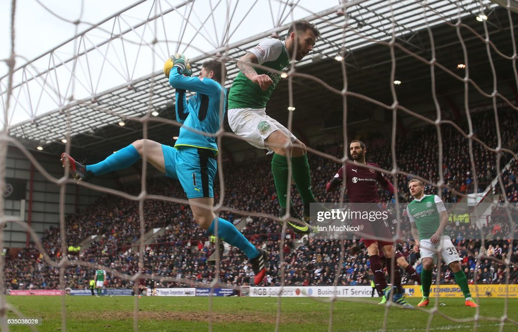 Jack Hamilton of Heart of Midlothian vies with Grant Holt of Hibernian during the Scottish Cup Fifth Round match between Heart of Midlothian and Hibernian at Tynecastle Stadium on February 12, 2017 in Edinburgh, Scotland.