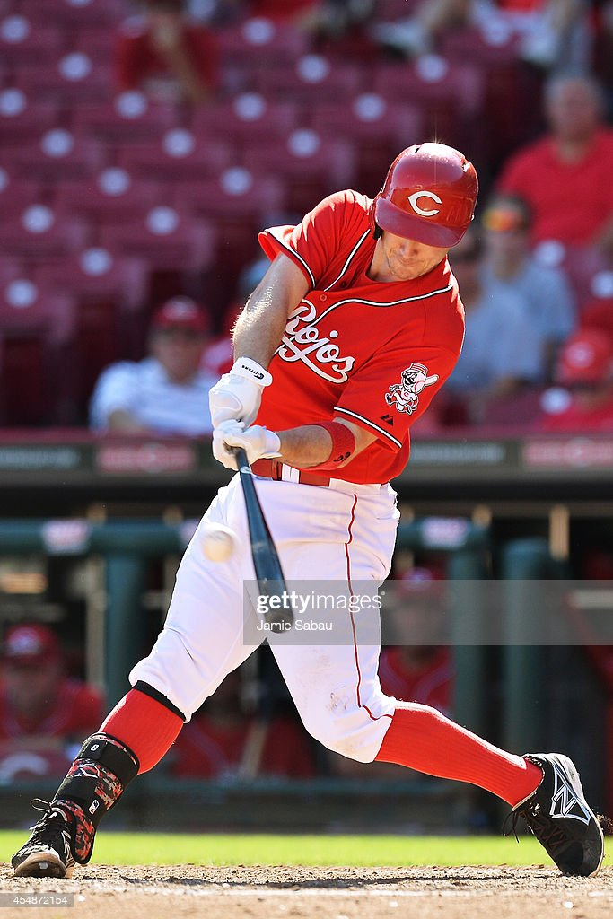 Jack Hannahan #9 of the Cincinnati Reds hits a double in the bottom of the ninth inning against the New York Mets at Great American Ball Park on September 7, 2014 in Cincinnati, Ohio. New York defeated Cincinnati 4-3.