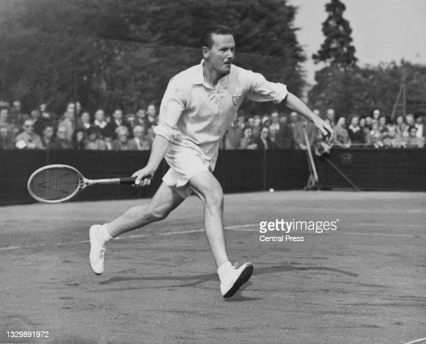 Jack Harper of Australia runs to make a forehand return to Kho Sin-Khie of China during their Men's Singles Final match at the Surrey Hard Court...