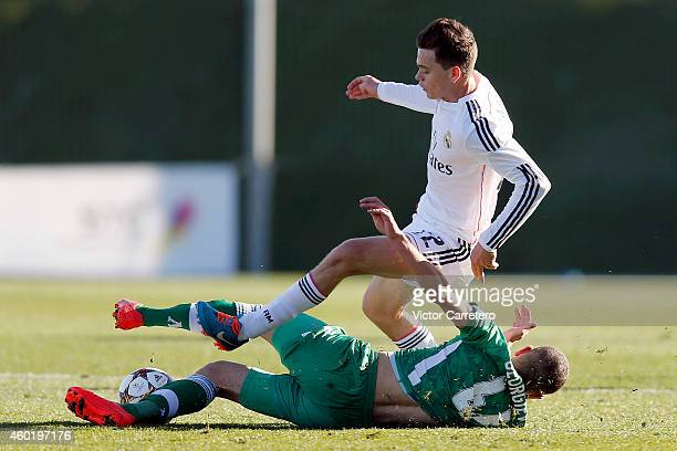 Jack Harper of Real Madrid competes for the ball with Aleksandar Georgiev of Ludogorets during the UEFA Youth League match between Real Madrid and...