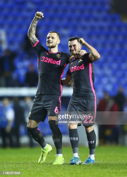 Jack Harrison and Liam Cooper of Leeds United celebrate at the final whistle during the Sky Bet Championship match between Reading and Leeds United...