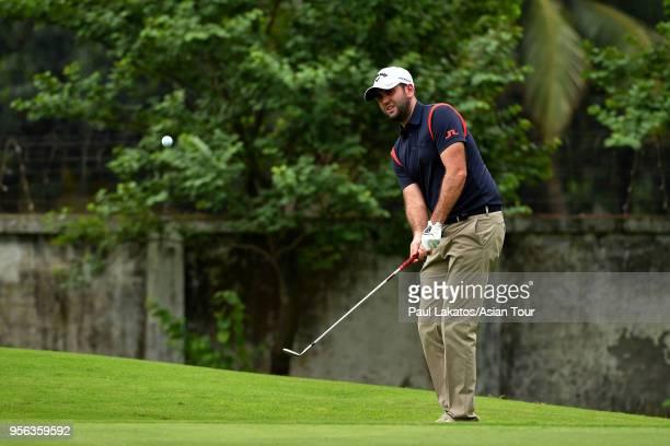 Jack Harrison of England plays a shot during round one of the 2018 AB Bank Bangladesh Open at Kurmitola Golf Club on May 9 2018 in Dhaka Bangladesh