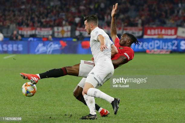 Jack Harrison of Leeds United and Aaron Wan-Bissaka of Manchester United contest the ball during a pre-season friendly match between Manchester...