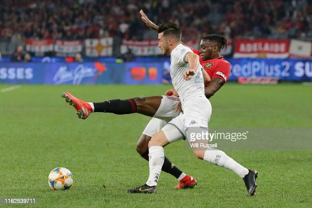 Jack Harrison of Leeds United and Aaron WanBissaka of Manchester United contest the ball during a preseason friendly match between Manchester United...