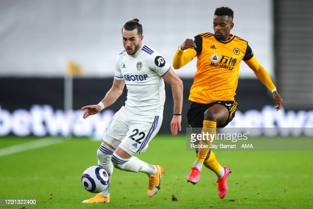 Jack Harrison of Leeds United and Nelson Semedo of Wolverhampton Wanderers during the Premier League match between Wolverhampton Wanderers and Leeds...