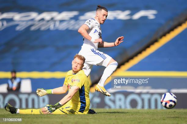 Jack Harrison of Leeds United beats Aaron Ramsdale of Sheffield United but misses the chance during the Premier League match between Leeds United and...