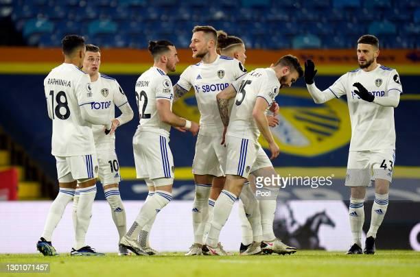 Jack Harrison of Leeds United celebrates scoring their sides first goal with Raphinha, Ezgjan Alioski, Liam Cooper, Stuart Dallas and Mateusz Klich...