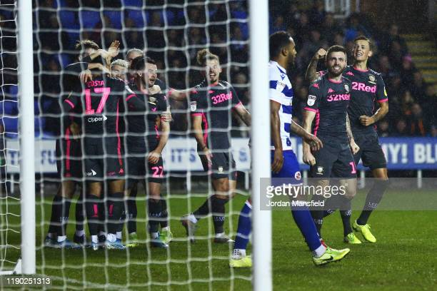 Jack Harrison of Leeds United celebrates with his teammates after scoring his sides first goal during the Sky Bet Championship match between Reading...