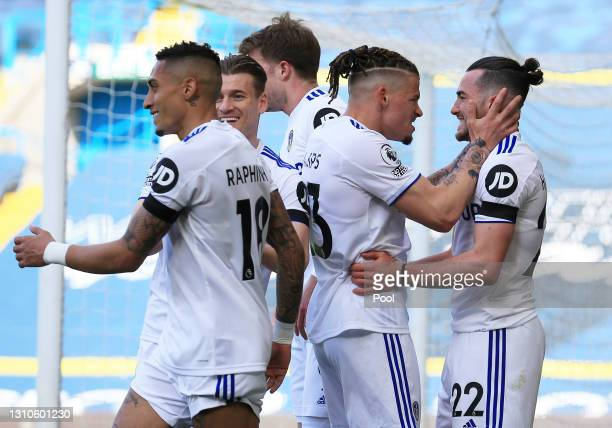Jack Harrison of Leeds United celebrates with Kalvin Phillips and teammates after scoring their team's first goal during the Premier League match...