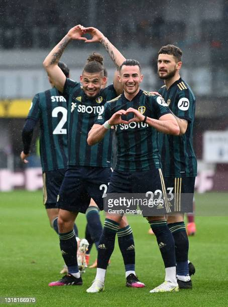 Jack Harrison of Leeds United celebrates with team mates Kalvin Phillips and Mateusz Klich after scoring their side's second goal during the Premier...