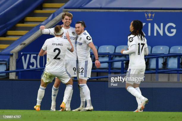 Jack Harrison of Leeds United celebrates with team mates Luke Ayling, Patrick Bamford and Helder Costa after scoring their side's third goal during...