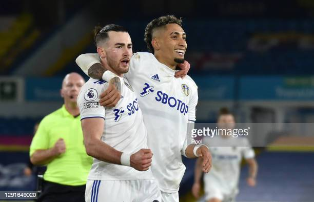 Jack Harrison of Leeds United celebrates with teammate Raphinha after scoring their team's fifth goal during the Premier League match between Leeds...