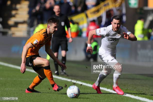 Jack Harrison of Leeds United gets past Robbie McKenzie of Hull City during the Sky Bet Championship match between Hull City and Leeds United at KCOM...