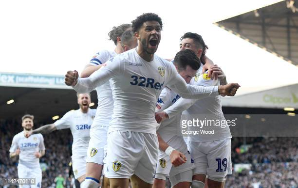 Jack Harrison of Leeds United is mobbed by with teammates Luke Ayling, Tyler Roberts, Pablo Hernandez after scoring the opening goal during the Sky...