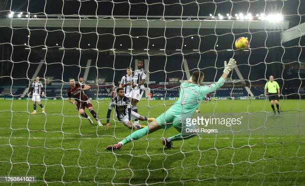 Jack Harrison of Leeds United scores his team's third goal past Sam Johnstone of West Bromwich Albion during the Premier League match between West...