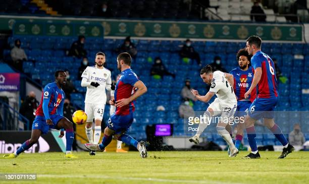 Jack Harrison of Leeds United scores their team's first goal past Gary Cahill of Crystal Palace during the Premier League match between Leeds United...