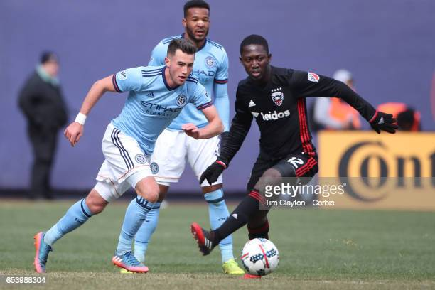 Jack Harrison of New York City FC challenged by Patrick Nyarko of DC United during the NYCFC Vs DC United regular season MLS game at Yankee Stadium...