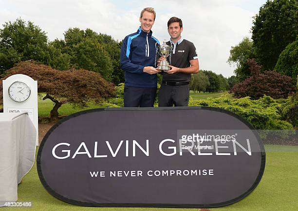 Jack Harrison of Wildwood Golf and Country Club is presented with the trophy by Dan Walker of the BBC during the Galvin Green PGA Assistants'...