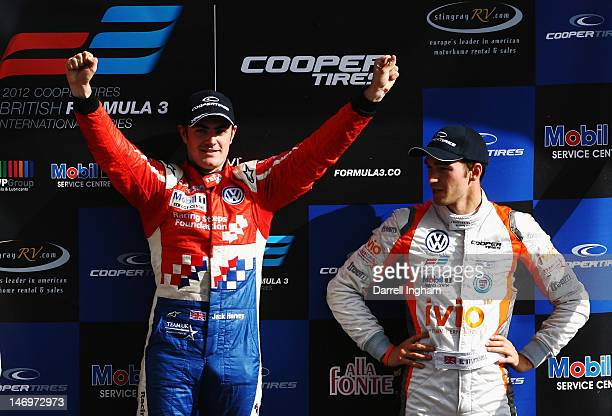 Jack Harvey of Great Britain and driver of the Carlin Dallara F312 Volkswagen raises his arms over Harry Tincknell after winning the Cooper Tires...