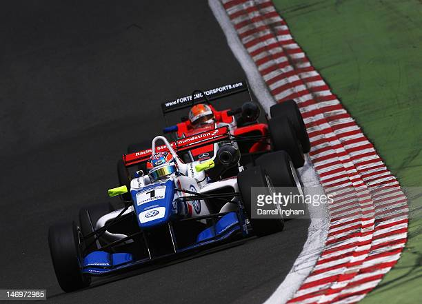 Jack Harvey of Great Britain drives the Carlin Dallara F312 Volkswagen during the Cooper Tires British Formula 3 Championship race at the Brands...