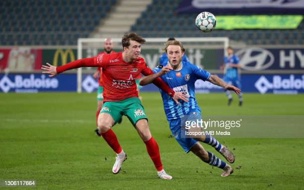 Jack Hendry of KV Oostende battles for the ball with Roman Bezus of KAA Gent during the Jupiler Pro League match between KAA Gent and KV Oostende at...