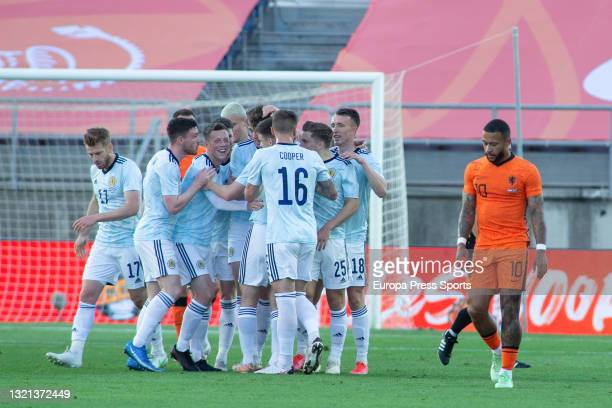 Jack Hendry of Scotland celebrates a goal with his teammates during the international friendly match played between Netherlands and Scotland at...