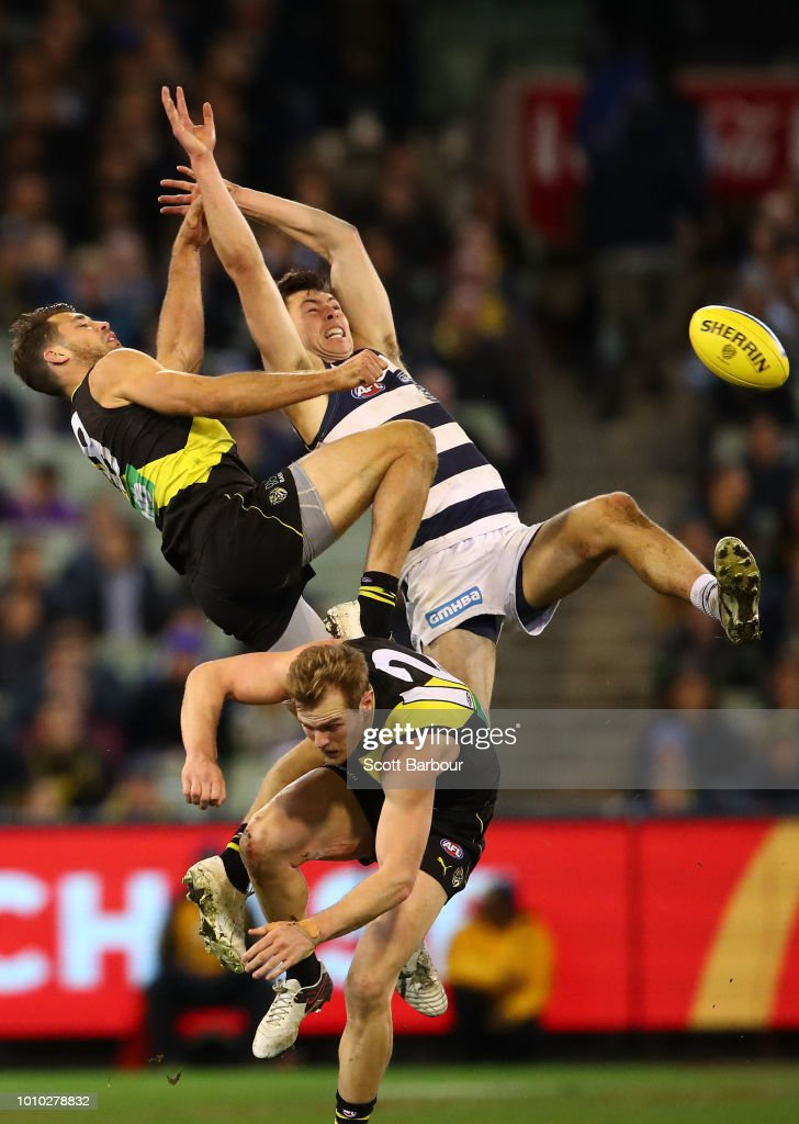 Jack Henry of the Cats and Alex Rance of the Tigers compete for the ball during the round 20 AFL match between the Richmond Tigers and the Geelong Cats at Melbourne Cricket Ground on August 3, 2018 in Melbourne, Australia.