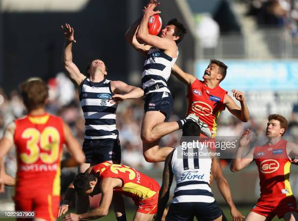 Jack Henry of the Cats leaps for a mark during the round 23 AFL match between the Geelong Cats and the Gold Coast Suns at GMHBA Stadium on August 25...
