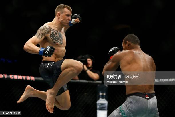 Jack Hermansson of Sweden jumps in the air to punch Ronaldo Souza of Brazil during their middleweight bout at UFC Fight Night at BB&T Center on April...