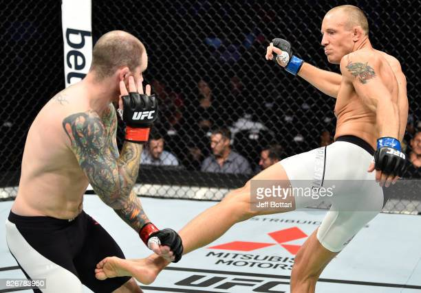 Jack Hermansson of Sweden kicks Bradley Scott of England in their middleweight bout during the UFC Fight Night event at Arena Ciudad de Mexico on...