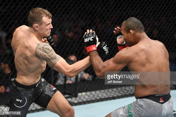 Jack Hermansson of Sweden punches Jacare Souza of Brazil in their middleweight bout during the UFC Fight Night event at BBT Center on April 27 2019...