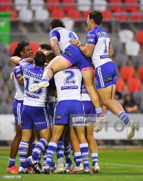 Jack Hetherington of the Bulldogs celebrates with team mates after scoring a try during the round 25 NRL match between the Wests Tigers and the...