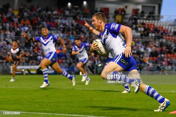 Jack Hetherington of the Bulldogs runs in to score a try during the round 25 NRL match between the Wests Tigers and the Canterbury Bulldogs at...