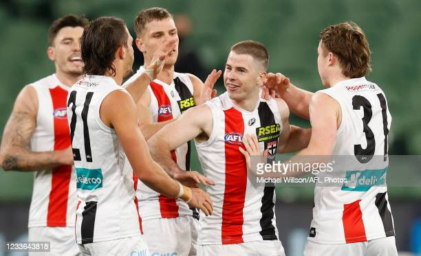 Jack Higgins of the Saints celebrates a goal with teammates during the 2021 AFL Round 15 match between the Richmond Tigers and the St Kilda Saints at...