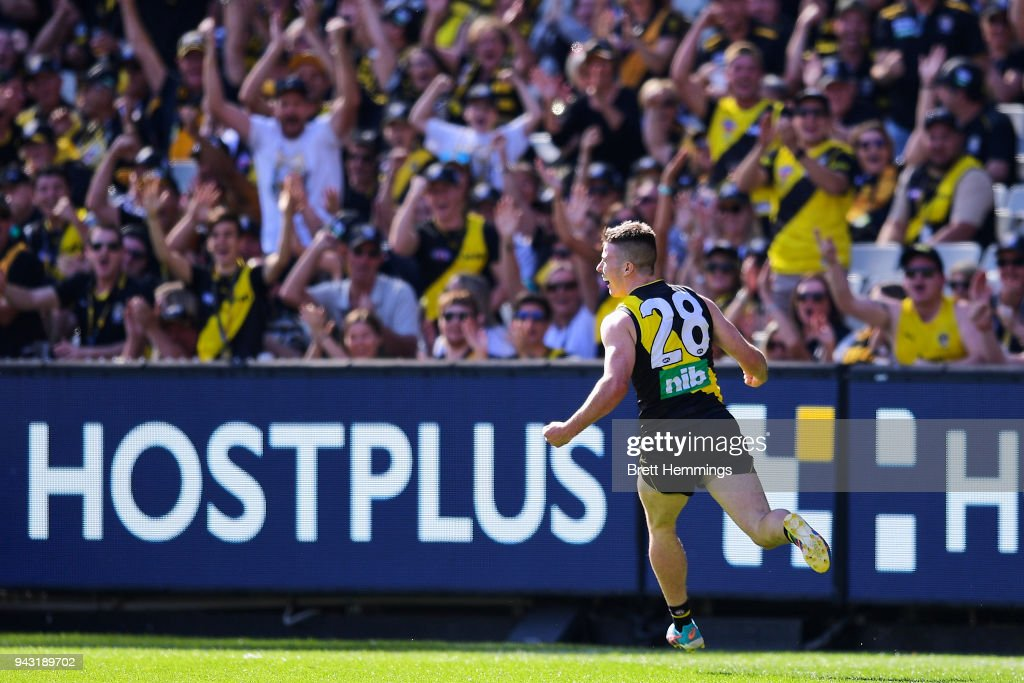 Jack Higgins of the Tigers celebrates kicking a goal during the round three AFL match between the Richmond Tigers and the Hawthorn Hawks at Melbourne Cricket Ground on April 8, 2018 in Melbourne, Australia.