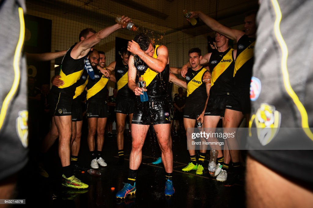 Jack Higgins of the Tigers celebrates with team mates after victory during the round three AFL match between the Richmond Tigers and the Hawthorn Hawks at Melbourne Cricket Ground on April 8, 2018 in Melbourne, Australia.